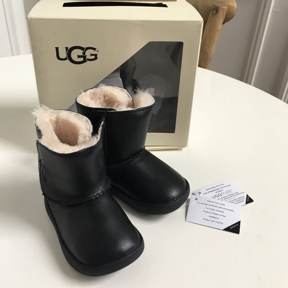 2998f713e14 Ugg Keelan black leather boots walker baby fur. M 5c6f487b9539f7a8106fa013